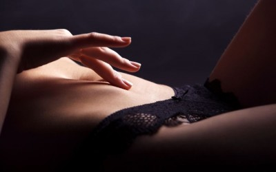 Playful hand touching abdomen