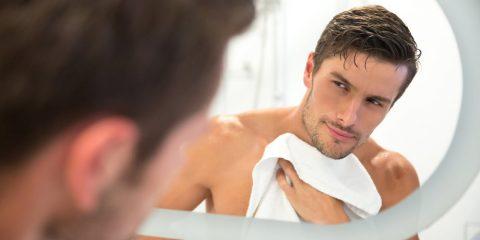 Portrait of a man washing in bathroom